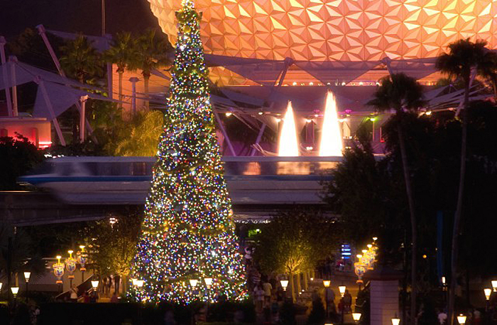 "The giant Christmas tree at Epcot, seen here glistening in front of the iconic Spaceship Earth attraction, is the centerpiece of the holiday celebration at the theme park in Lake Buena Vista, Fla. It's all part of the park's annual ""Holidays Around the World"" celebration, in which international traditions of the season unfold all throughout World Showcase. Epcot is one of four theme parks at Walt Disney World Resort. (Garth Vaughan, photographer)"