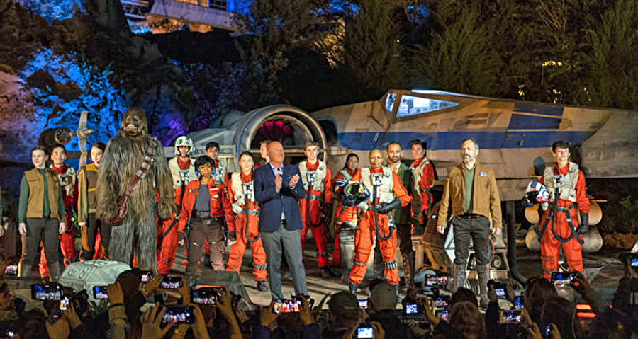 Bob Chapek, chairman, Disney Parks, Experiences and Products, is joined by a cast of Star Wars characters for the official dedication of Star Wars: Rise of the Resistance at Disney's Hollywood Studios, Dec. 4, 2019. Opening to the public Dec. 5, 2019, inside Star Wars: Galaxy's Edge at Walt Disney World Resort in Lake Buena Vista, Fla., the groundbreaking new attraction invites guests into a climactic battle between the Resistance and the First Order in a thrilling Star Wars adventure of galactic proportions.